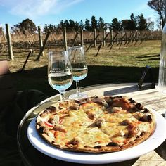 What was the favourite part of your long weekend in Canberra? Instagrammer fipre's was enjoying the new @fourwindsvineyard 2015 Riesling with wood-fired pizza in the sun at the Murrumbateman cellar door. Sounds pretty perfect to us! #visitcanberra #restaurantaustralia