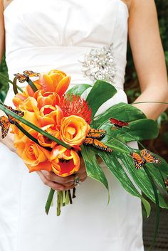 Wedding bouquets- Bridal Bouquet - Bright orange flowers, tropical green leaf and with butterflys. - cascading bouquet style