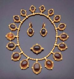 Victorian Demi-Parure Comprising Of A Necklace, Brooch And Earrings Made Of Amber Set In Gold - Italian (Rome)   c.1860-1870  -  In The Swan's Shadow
