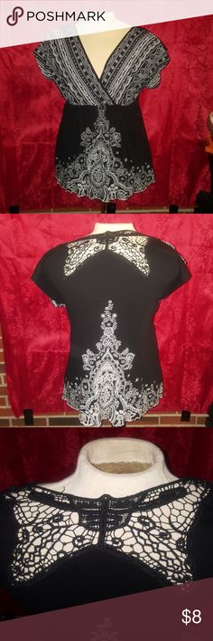 XL black and white blouse Intricate black and white blouse with a mesh butterfly on the back shoulders. Gently used, no rips, tears, or stains. Smoke free, pet free home. Cato Tops Blouses