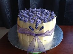 ... cream in the middle layer and to cover the cake. White choc panels and