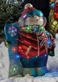 Adorned with dazzling LED and fiber-optic lights, this adorable snowman celebrates the joys of winter while warmly greeting guests. Painted with vibrant metallic paints and crafted for both indoor and outdoor use, this cheerful snowman adds a touch of whimsy to any holiday display.