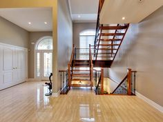Stunning foyer - polished porcelain tiles and custom, solid wood staircase. Polished Porcelain Tiles, Wood Staircase, Foyer, Ontario, Solid Wood, Community, Furniture, Home Decor, Decoration Home