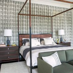 Love this bedroom by @rethinkdesignstudio featuring our Ripple fabric in Smoke as curtains along the back wall. Joel and Erika of @rethinkdesignstudio cleverly concealed a second door behind the curtains for better flow of the room. I love how this pattern becomes a calm textural focal point for this cozy bedroom. #rebeccaatwood #RAatHome
