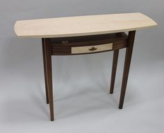 """""""flight"""" hall table with ripple sycamore wing top and floating drawer"""