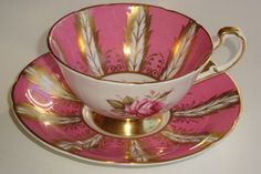 """Paragon Pink & Gold Leaf Raised Rose Tea Cup and Saucer. 3-7/8"""" x 2¼"""" cup & 5½"""" saucer. $165.00 and she wants $24.50 shipping...ouch. janshelley on ebay, 2/11/16"""