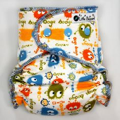 This listing is for a Made-to-Order (You Pick Size and Style) All-in-Two Cloth Diaper in the Blue and Orange Ooga Booga on Cream print. The pictures are representative of the print (made into a size Medium/Long Wind Pro AI2), but your specific diaper may look slightly different.  Little Boppers™ handmade All-in-Two cloth diapers are plush, stylish and stashworthy. Super easy...just put it on your baby and go! No separate cover needed. Add one to your babys cloth diaper stash today!  Fea...