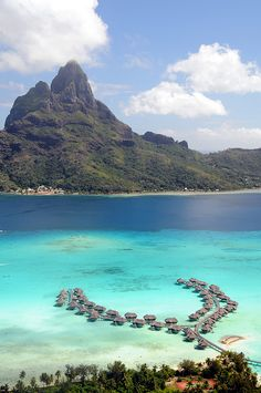 Bora Bora | a fairy-tale creation of jagged volcanic peaks juxtaposed against crystal-clear aqua lagoons.