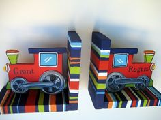 hand painted train bookends in navy, red , green and orange stripes to match Ryder bedding