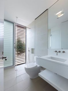 white bathroom; curbless shower