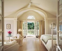 Romantic style-French doors in & out of this master, plus the arched alcove & transom window