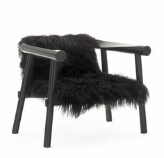 The Altay armchair is made of a solid beech frame, natural varnish or black gloss finish. The seat is covered with       Mongolian goat skin (black or white) or black full-grain leather....