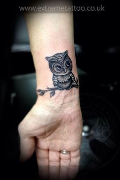 Owl tattoo. Cute! Love the placement too!