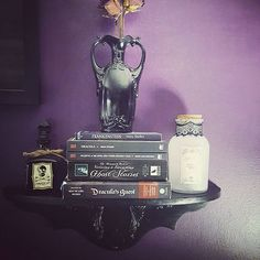 """Part 1 of thrifty goods makeover! Swipe to the other photo for the """"before"""". Painted the shelf and added detailing and the vase and large jar had some decent changes too🎃. #diy #goth #bramstoker #gothichome #vase #vintage #books #curio #dracula #maryshelley #creepy #creepycute #roses #gothic"""