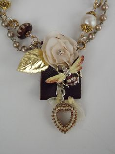 """Vintage Jewelry Assemblage, titled, """"BEE LOVED"""", created with repurposed leather, fabric and vintage jewelry"""