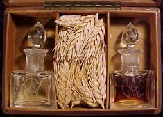 This wages box from Jerusalem was used to present new Fellowcraft Masons their wages of corn (wheat), wine and oil on their journey through the middle chamber.  The box is made of olive wood and contains two hand-blown crystal bottles with the Square and Compasses engraved on the face of them.  One bottle contains olive oil and the other Jerusalem wine.  In the center compartment is the wheat, which was raised in that country.