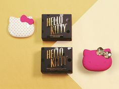 HELLO KITTY BIG PINK BOW This collection is Hello Kitty like you've never seen her before - glamourous, bold, refined, and elegant. The primary components of the collection (the bottles and compacts) feature gold hardware, glass, and bold pops of hot pink. The secondary packaging is minimal and refined, but still feminine and delicate.