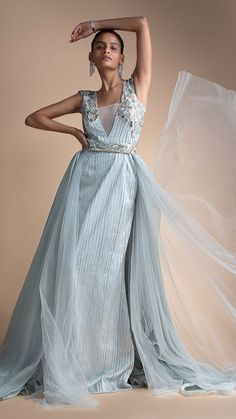 Cloud grey embellished net gown with detachable trail. Sleeveless gown adorned with cut dana embroidery. Powder Blue Gown, Net Gowns, Silver Falls, Bugle Beads, Skyfall, Western Wear, Designer Dresses, Weave, Blues