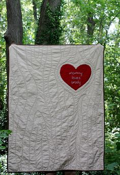 amazing quilt. Love the woodgrain quilting and the heart #quilt