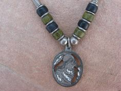 Black Leather Necklace with a Pewter Wolf by buffalorunjewelry