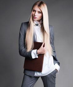 Work the Look: Dress for Success - The New Tailoring - Boss Black blazer and pants. Dries van Noten turtleneck. Robert Lee Morris collar. Ann Taylor cuff. Coach clutch.