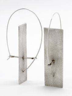 Solitary Plane Earrings by Sarah Mann. Uniquely designed planar sterling silver earrings, with integral ear wire.
