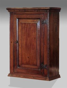 Eighteenth century oak wall cupboard, moulded cornice over panelled door enclosing two shelves. Retaining Lovely original iron butterfly hinges. circa. 1770 £780