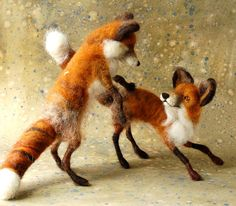 made 4 needle felted foxes this week...