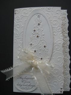 Oyster Stamps Gallery:  Love all the embossing and the tree on this monochrome card. Looks like the die cut was used to just emboss, and not cut through the tree.  Must try this out.