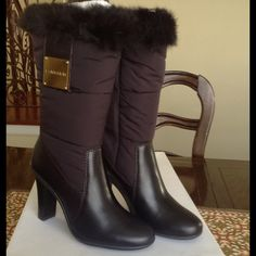 """Calvin Klein Mid Calf Dark Brown Puffy Fur Boots CALVIN KLEIN MIDCALF ( FLOOR TO TOP  measures approx 13 1/2"""".)BOOTS. SIZE 8 1/2 M.  DARK BROWN LEATHER FOOT NYLON PUFFER LEG, WITH FUR TRIM AROUND TOP. HIDDEN INSIDE ZIPPER WITH VELCRO CLOSURE. LARGE GOLD PLATE ON OUTSIDE OF EACH BOOT THE SAYS CALVIN KLEIN. 4"""" HEELS. RUBBER SOLE. SOFT WARM LINING. BRAND NEW UNWORN Calvin Klein Shoes"""