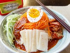 Bibim Naengmyeon - Korean spicy cold buckwheat noodles are mixed with vegetables and kimchi for a sweet and savory meal! Yum!