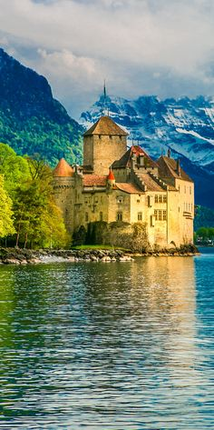 Chillon Castle on Lake Geneva, with Alps in the background. 10 Things to do in Montreux, Switzerland #travel #Europe #vacation