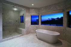 #christinaaguilera keeps her bathroom simple, so as to not detract from the gorgeous view.