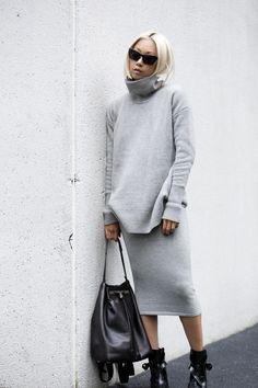 Vanessa Hong is wearing agrey knit turtleneck and skirt fromWhistles, backpack from the The Row and the boots are from Zara