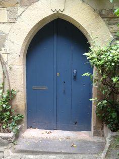 love the peak top of this door in France