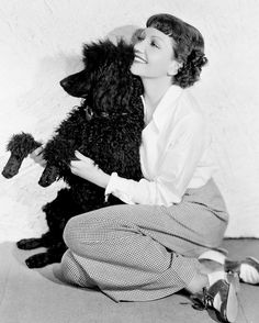 Claudette Colbert and poodle excited about going to the Poodle Peace Parade.