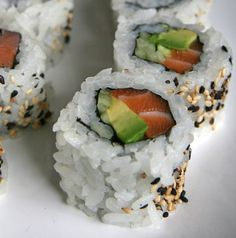Salmon Roll With Avocado:  Salmon maki roll (six pieces): 220 Add avocado: 80 Mixed greens: 8 Miso dressing: 60 Miso soup: 40 Low-sodium soy sauce (2 tablespoons): 20  Total Calories: 428 calories Source: Flickr User quinn.anya