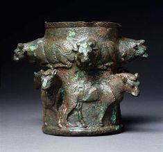 Copper alloy vase decorated  bull friezes, Susa, Iran, ca. 1200-1000 BCE 11.5 cm high. Photo: Reproduced by courtesy of the Louvre, Paris.