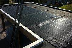 zonne-enegrie tubes op platdak