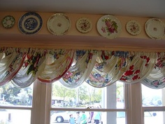 decorating with plates + vintage linen curtains
