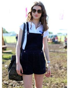 We love the schoolgirl approach to model Tali Lennox's look. Her black jumper and vintage Lacoste polo are the perfect mix of sweet and sexy.