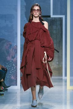 AtMarni, too, there was this use of surface movement to create texture. Consuelo Castiglioni showed off shoulders through dresses that draped and pulled here and there, and weighed her models...