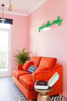 Eclectic, pink living room. Stunning renovation by Sarah Akwisombe.