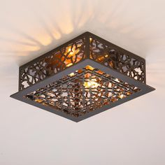 Reproduction Iron Grate Flush Mount Ceiling Light Reproduced from our popular vintage floor grate ceiling lights, this exclusive cast-iron quatrefoil cutout light casts artistic patterns of light whether you use it on the ceiling or on the wall. Choice of vintage Cream, Bronze or Black.