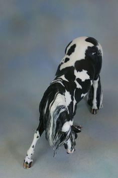Vincenzo resin, sculpted by Brigitte Eberl, painted by Myla Pearce to a gorgeous black tobiano, owned by Dream Walker Stables