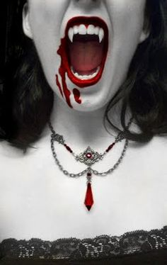 Vampire pic... I love her necklace. That's more like what I think of for vampire attire.