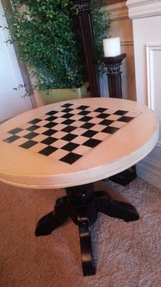 Garage sale table redo, painted cream and black with a checkerboard on top. { Follow City Chicken on Facebook }