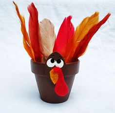 Turkey Treat Pot - This makes a wonderful Thanksgiving gift for your host and is something you and your child can make together. You can also substitute the feather for your child's hand traced on different colored papers.