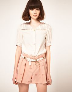 Gamine - love the soft colour hue more than this outfit.
