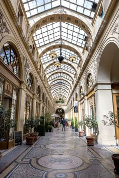 Peruse the skylit arcades—Galerie Vivienne, Passage des Panoramas, Galerie Véro-Dodat, and Passage Colbert are all great options. They're the city's original shopping malls and full of tiny boutiques, bookstores, antique shops, cafés, and more uniquely Parisian spots.